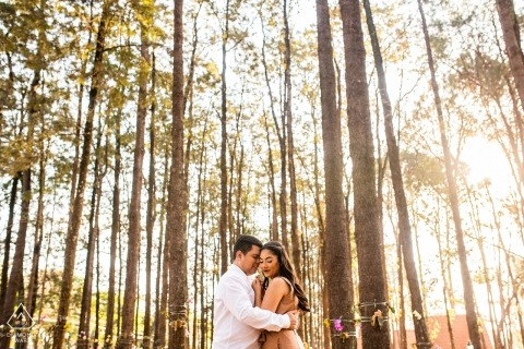 Holambra - São Paulo couple near to the trees during engagement photo session
