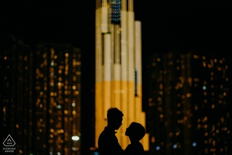 Ho Chi Minh City engagement photo session at night in the city.