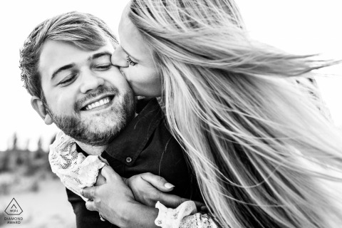 Avalon, New Jersey engagement session in black and white with wind and hair blowing
