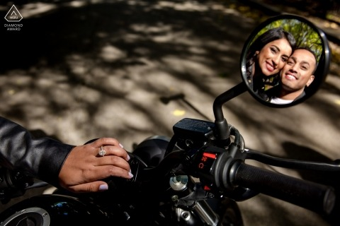 Chicago, IL couple reflected in motorcycle mirror - Engagement session with ring detail and bike