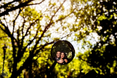 Chicago, IL Engagement session using a motorcycle mirror in the trees