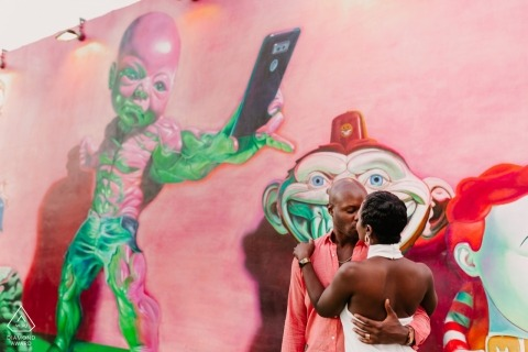Couple kissing in Wynwood, Miami, FL - Engagement Photography with Pink Wall Mural
