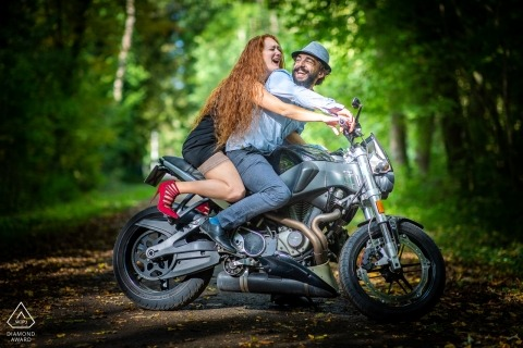 Forêt du Neuland - Colmar Engagement Portraits - Crazy laugh on the bike - Motorcycle Pre Wedding Shoot