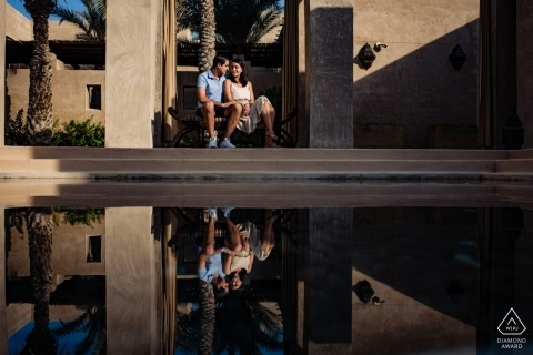 Bab Al Shams Resort, Dubai Engagement photo of a couple relaxing by the water