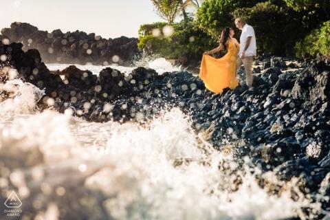 Hawaii Engagement Photographer: Splashing waves with couple on the rocks at Makena, Maui