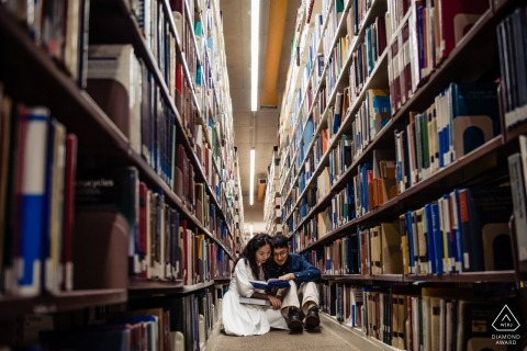 St Johns University Library in Newfoundland - Engagement photo session with a couple reading books