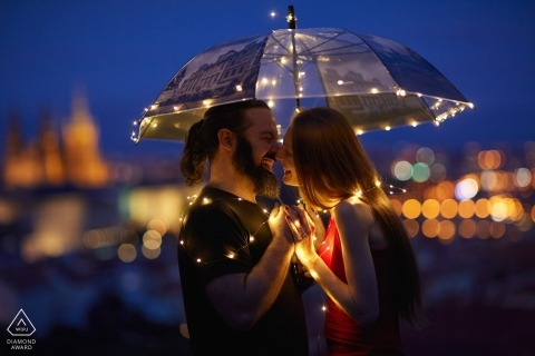 FR and AU couple during their night time engagement session in Prague