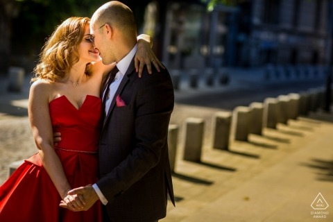 Romania Bucharest Couple kissing on the street during engagement portrait session