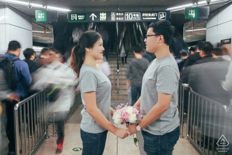 China Beijing prewedding portrait at the train/subway station ... holding a bouquet of flowers