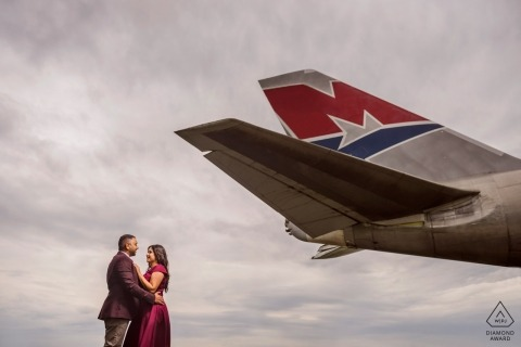 Engagement Portrait Session at the Cotswald Airport, UK with tail of airplane