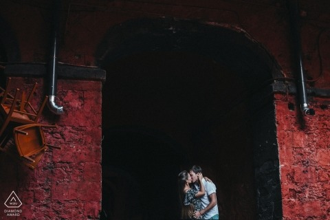 Odessa Ukraine Engagement Portrait — a couple kissing in front of a red bridge
