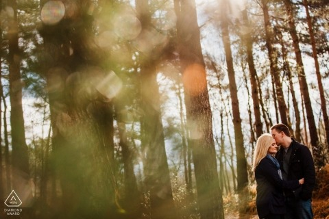Heath, West Sussex Woodland love portrait of a couple in the trees and sunlight.