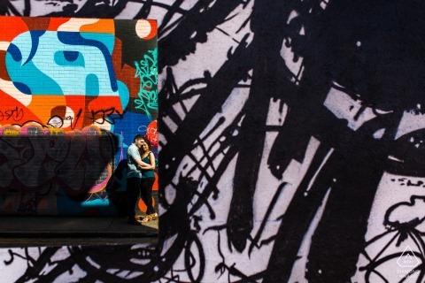 Shoreditch, London Graffiti love engagement portrait - Photography with wall art murals.