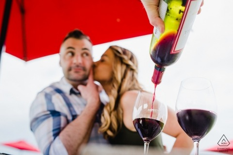 Greenhill Winery, Middleburg, VA | Her kiss, red wine and red umbrella
