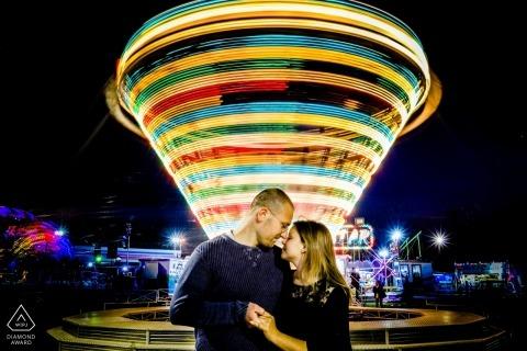 Siracusa luna park slow-shutter engagement portrait with blur.