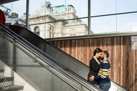 Opera - Vienna Austria engagement photography | A couple kissing on the escalator