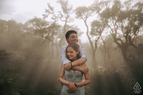 Khanh Vinh, Vietnam pre wedding pictures - A hug to warm you up with fog and mist in the trees.