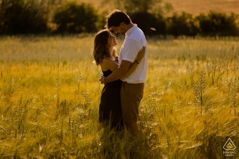 Spain Couple at sunset posing for pre-wedding portrait in the tall grass.