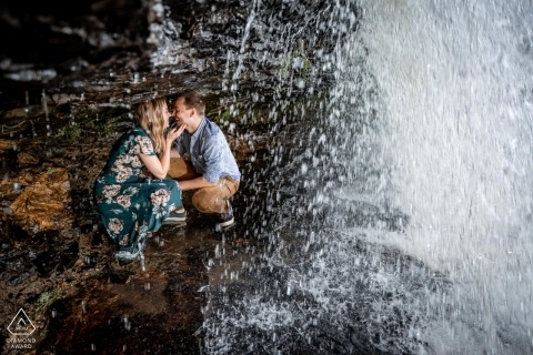 Willow Falls engagement portrait session with a Couple under waterfall