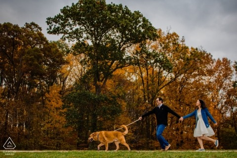 Columbia, Maryland engagement session while walking the dog | Whose leading who?