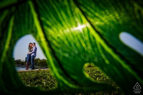 fullerton beach engagement shoot - couple and a green leaf