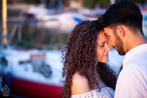 Bolsena Italy engagement session - Couple having a magic moment in the harbor