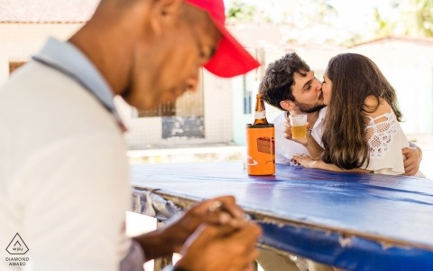 Alagoas, Brazil Engagement Photo Session - Portrait contains:Couple who loves beer doing the pre wedding in a bar