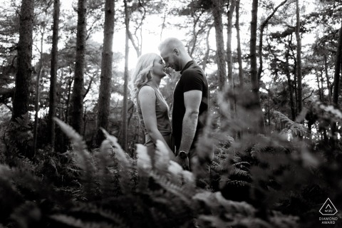 Chicksands Wood, UK Engagement Portrait Session - Image contains: face, facing, each, other, trees, sunlight, ferns