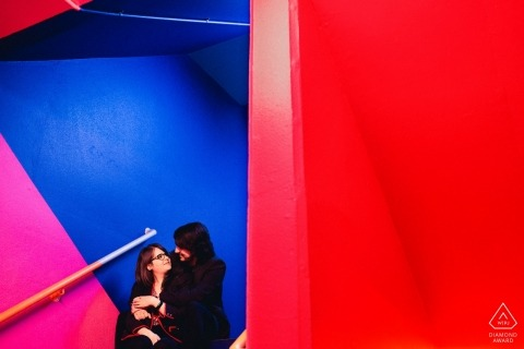 RS, Brazil Engagement Picture Session - Portrait contains: colorful, stairs, sitting, red, blue