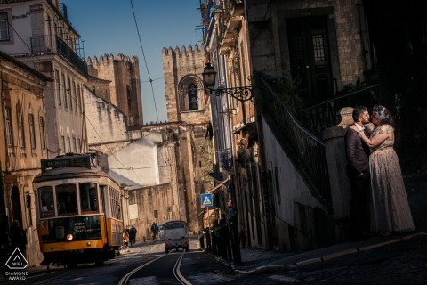 Alfama, Portugal Engagement Photography - Portrait contains: cable car, trolly, streets, train, light, sun