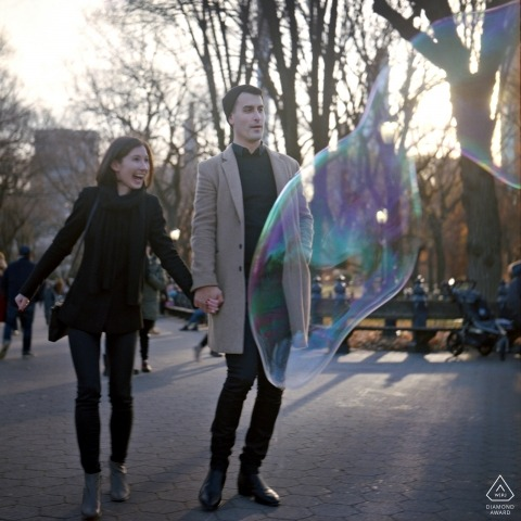 Central Park, NYC - The wonders of Central Park - Engagement Photography - Portrait contains: walking, bubbles, winter, trees, trail