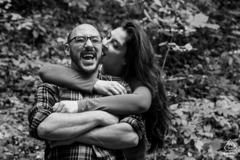 Helen, GA Engagement Couple Session - Image contains: bite, ear, laughing, fun, smiles, trees, black, white