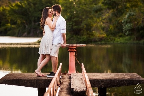Rheinland-Pfalz Engagement Couple Photography - Portrait contains: water, dock, pond, lake, embrace, white, clothing