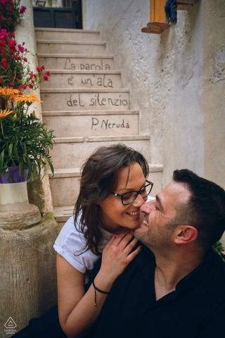 Umbria Engagement Couple Session - Image contains: sitting, couple, stairs, village, hug