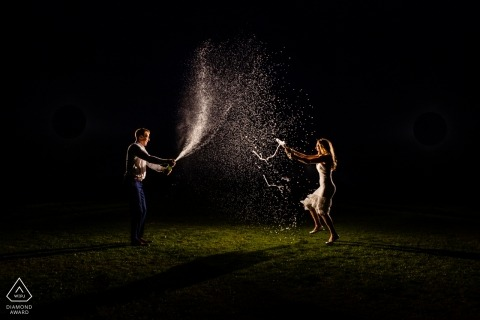 Malibu Engagement Portrait Session - Image contains: Lit, Night, Spray, Couple, Champagne