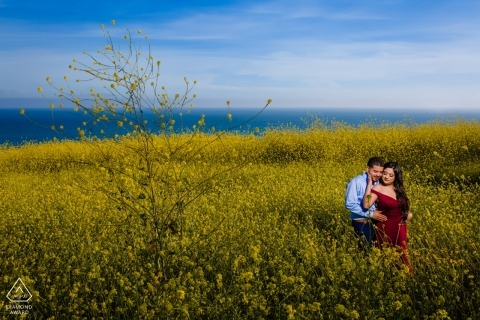 Malibu, California engagement photos - Couple in field of yellow flowers