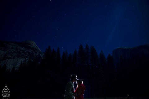 Yosemite Engagement Couple Photography - Portrait contains: lit, night, trees, sky, blue, stars