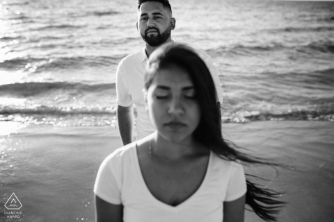 Western Australia Perth Couple, Together on the beach. | Engagement Couple Session - Image contains:water, waves, sand, black, white, wind, hair