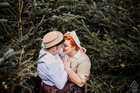 Netherlands Appelscha Engagement Photography - Image contains: pine, trees, couple, hats