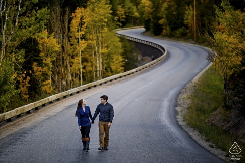 Engaged couple walk together on a road in Georgetown, CO - Pre Wedding Portrait Session