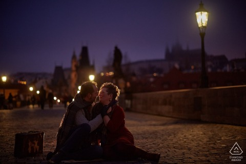 Charles Bridge, Prague, Czech Republic engagement photo session | A couple enjoys the quiet views atop the historic Charles Bridge at night.