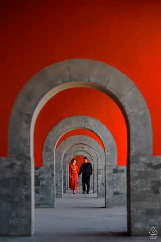 Beijing Forbidden City Pre Wedding Session - A couple walking during portrait session at Time tunnel of love