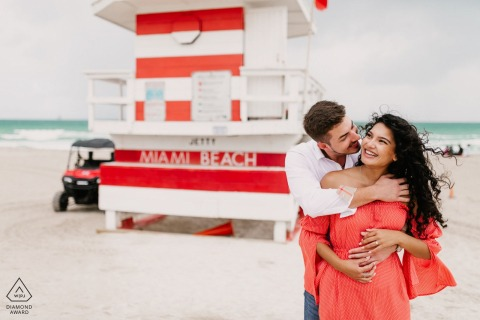 Florida lifeguard tower photography session for a couple at South Pointe Park, South Beach