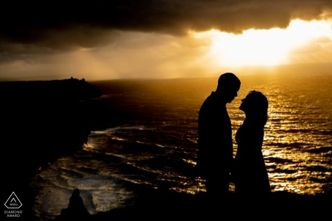 Cliffs of Mohr - Ireland Wedding And Engagement Photography - Storm on the horizon with a couple below