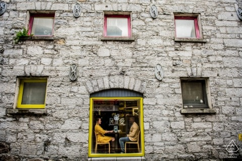Engagement photography at a Coffee Shop in Galway| A couple Sitting by the window
