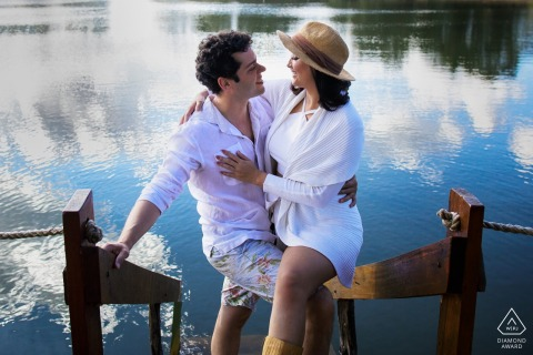 Brazil Teresópolis Engagement Session Photography - Portrait contains: water, dock, boat, ramp, beach, lake, hug, couples