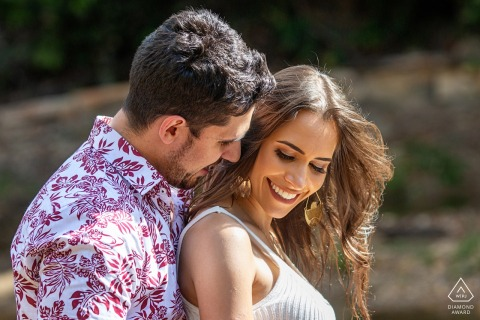 Brazil Pirenópolis Engagement Portrait of a Couple - Image contains: sun, light, embrace, hug, smiles, hair