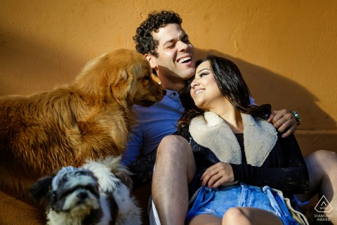 Brazil, Teresópolis Engagement Photo Session - Image contains: dogs, couple, laughing, fun, sunlight