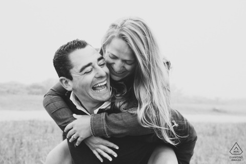 Sankaty Lighthouse, Nantucket Island Couple shares a genuine laugh during their engagement session.