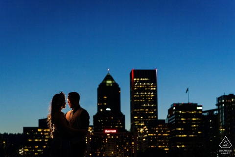 Couple share their loving engagement photo session with the background of Portland Oregon